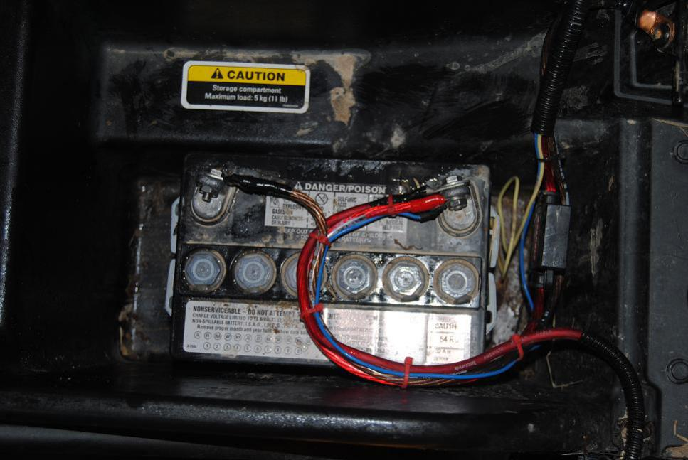 can am mander battery location